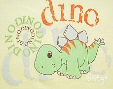 Body žluté s dinosaurem